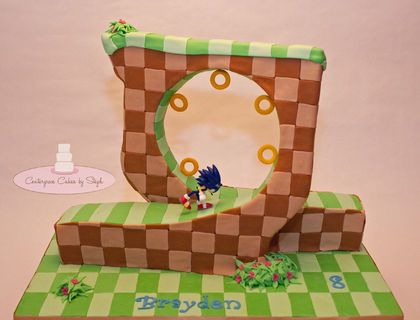 I made this Sonic the hedgehog cake for my amazing little man Brayden's 8th birthday! He has really been into sonic for the past year and when I was asking him about his birthday cake he wanted something different... something that sonic could actually be running across! I'm not gonna lie - I had a little melt down when he said he wanted the LOOP! Especially because we were traveling 3 hours away to celebrate his birthday! But of course I had to make it happen! So here it is.. Brayden's…