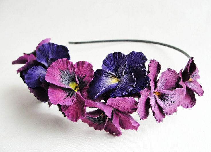 Pansy headband:) All flowers are made completely by hand from Claycraft by deco - air dry clay that is soft, durable and lightweight, non toxic. Keep it up from water or liquids. The flowers requires careful handling.