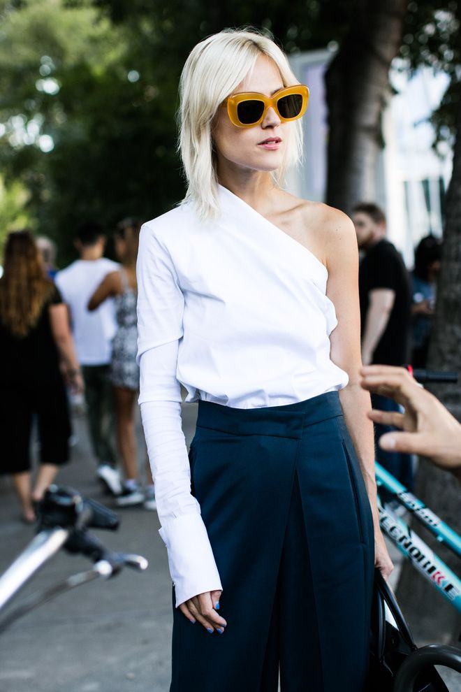 oversized sunglasses and one shoulder shirt and wide leg pants create a fashion-forward every day outfit