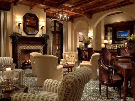 wood accents and graceful arches define this clubhousethe tile in the mantel echoes the furnishings new homes in the old palm golf club community - New Homes Palm Beach Gardens