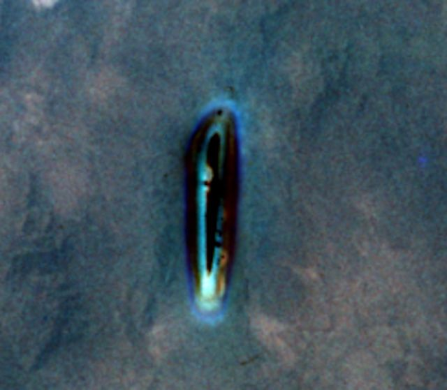 Alien UFO Sightings: Bright Blue Metallic UFO Photographed By Astronaut