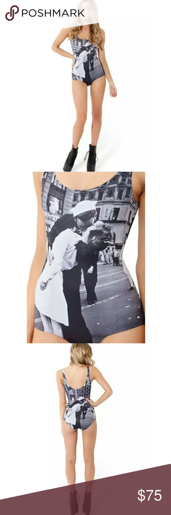 NWOT The Kiss Black and White Swimsuit NWOT new without tags The Kiss Black and White Swimsuit, tried on but never worn. Iconic photo taken in New York Times Square during WWII.  As far as iconic images go, this one's hard to top!  Composition: 82% Polyester, 18% LYCRA® Caress Lining: 85% Nylon, 15% Elastane Made in: Australia Blackmilk Swim One Pieces