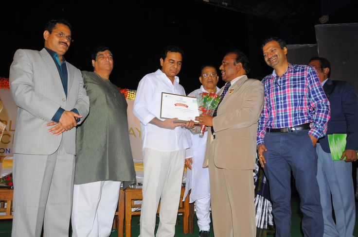 Pragati Group Chairman & Managing Director Dr. G.B.K. Rao and Joint Managing Director G. Ajay Chandra receiving Best Theme Based Resort award from K. Taraka Rama Rao, Minister for IT & Panchayat Raj conferred by Department of Tourism, Govt. of Telangana on 27.09.2015.