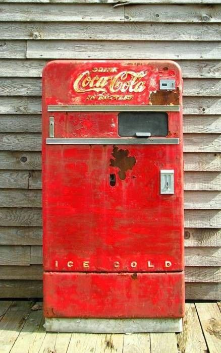 Vintage Coca Cola soft drink vending machine.. would make an incredible bar