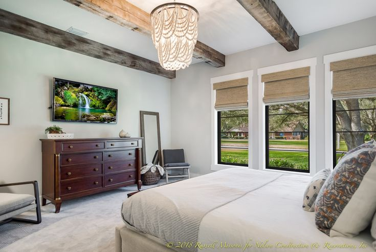 We LOVE this elegant beaded chandelier and decorative beams our clients selected for their master bedroom.  This was a home addition and whole home remodel in Brandon, Florida.