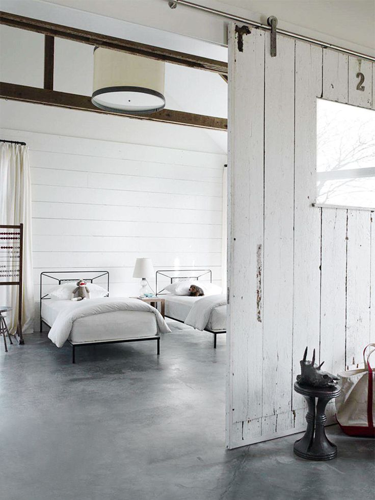 Love the polished nickel hardware and distress white barn door- modern, rustic, beachy... Beautiful!