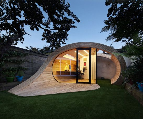 interesting of the round unique house shaped as chic front facade with black glazed framed wood and some trees around
