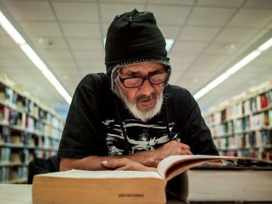 Portraits of homeless people using libraries