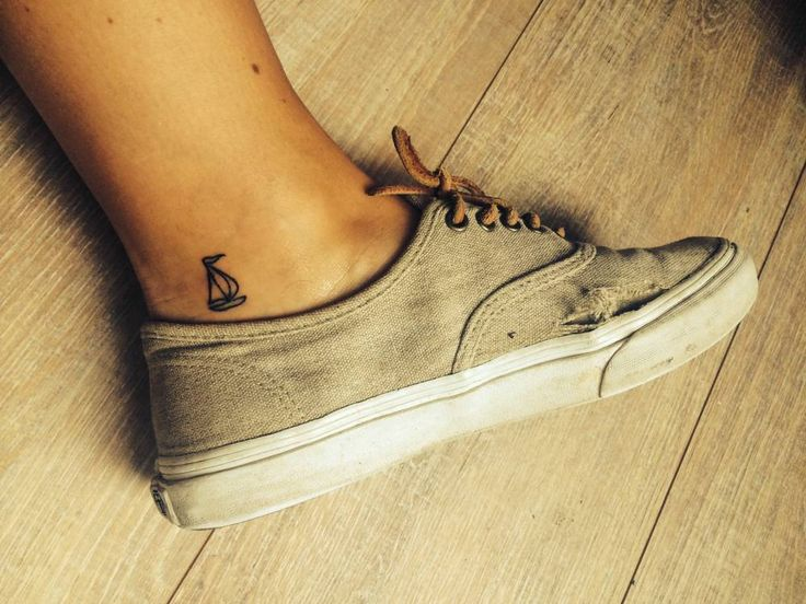 Little sailboat tattoo on the ankle.
