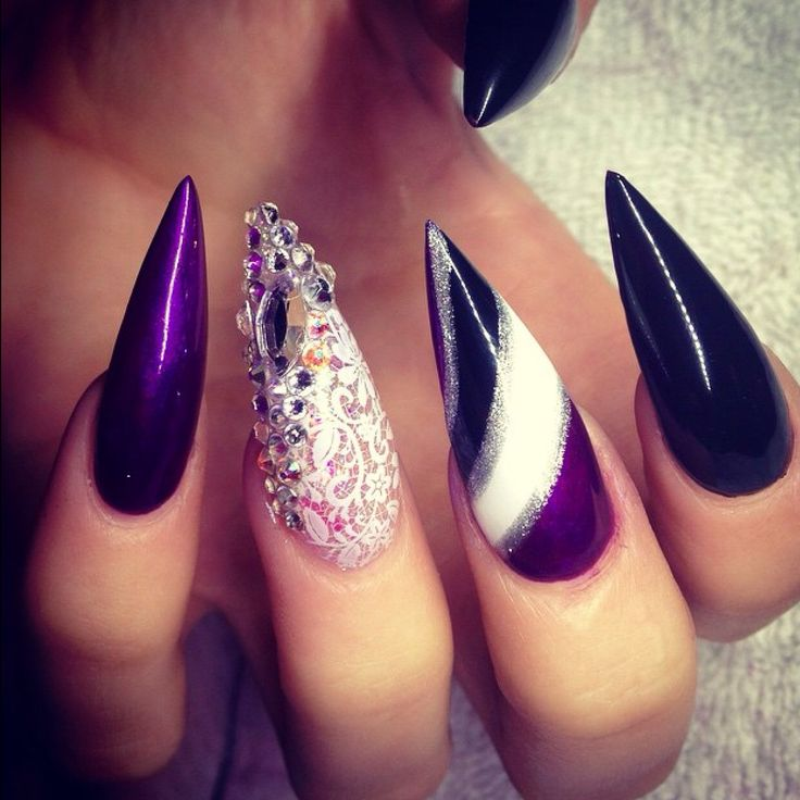 Long pointy stiletto nails with bling.