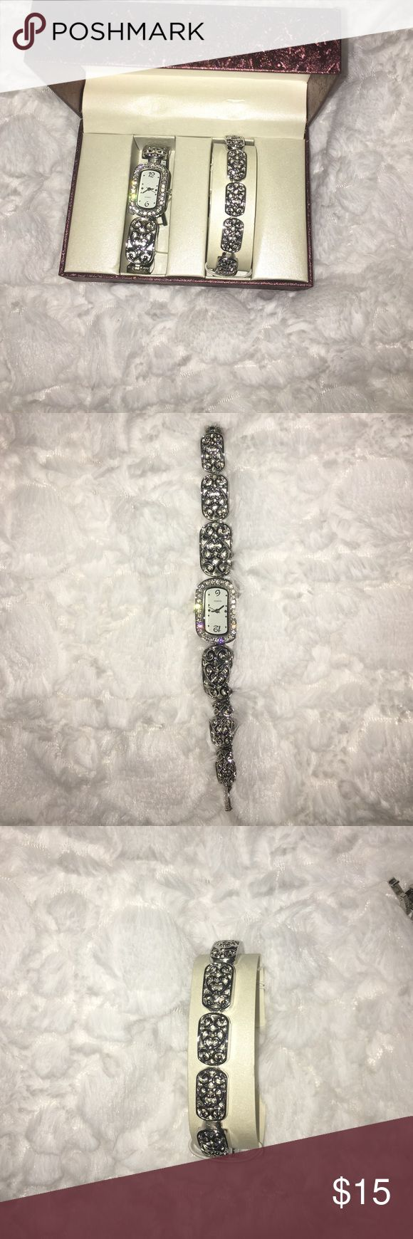 Diamond watch This is a silver rhinestone watch with a bracelet watch was made in China comes with box.   https://www.mercari.com/u/658677413/  Free cosmetic sample gift with the purchase of $20 and over Jewelry Bracelets