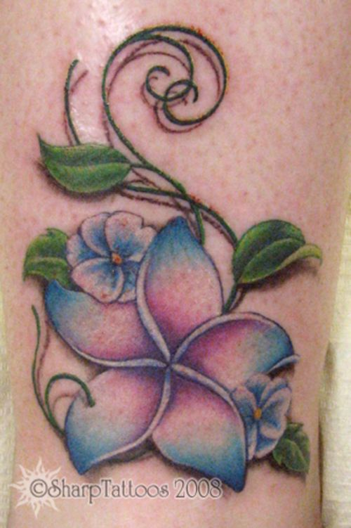 tropical flower tattoo...different colors and with Natalie's dob and initials...