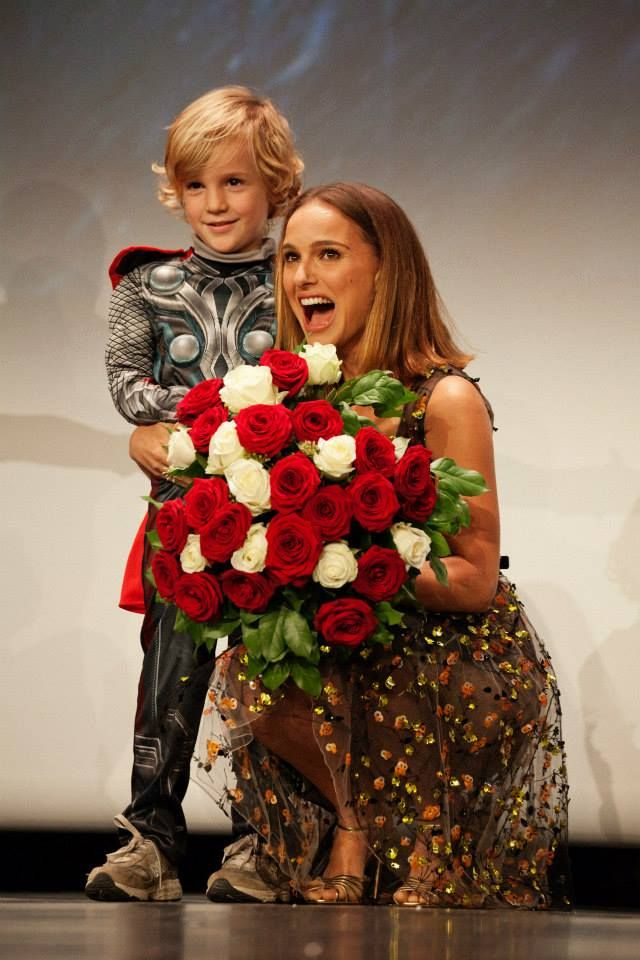 Natalie Portman (Jane Foster in Thor movies) enchanted after receiving flowers from a kid Thor in Paris premiere of Thor: The Dark World