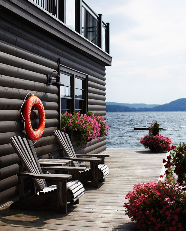 Don Tapscott's log cabin-style boathouse is topped by a large deck with a built-in stereo system.