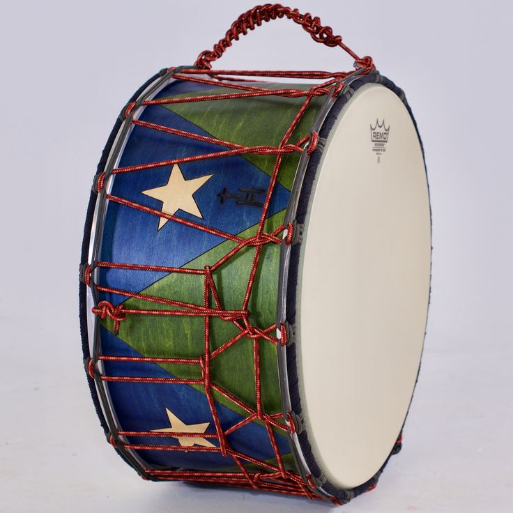 https://flic.kr/s/aHsm7KWyAy | Blue Stars Tupan | This beautiful custom order tupan features hand-burned zig zags and stars, rope-tensioned heads, and an internal mic.  What a sweet drum!  10x18; plied maple; satin wax.  To see more pix, and search our entire TreeHouse archive for your favorite specs, visit our photo gallery: www.treehousedrums.com/photos