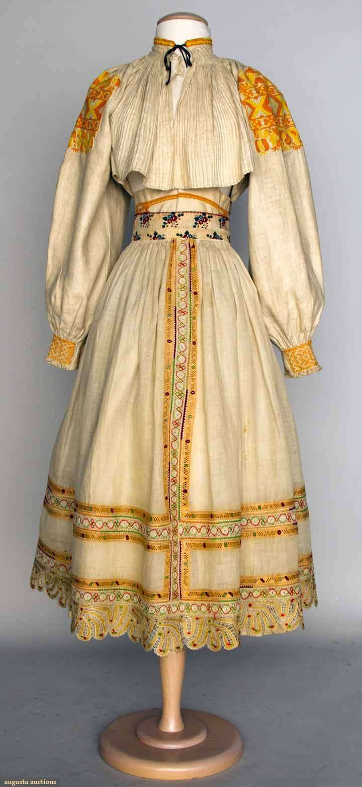 "Augusta Auctions, April 17, 2013 - NYC, Lot 134: ""Regional Separates"", Slovakia, Late 19th C Incomplete costume: blouse & skirt w/ orange & yellow embroidery, (light stains); apron w/ multi-color silk lace, very good. BM"