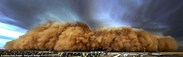 !!!!! On the move: A massive sand storm hits a village in Golmud in the Qinghai Province. The region is near the edge of the Gobi desert