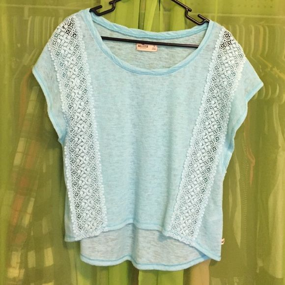 Light blue airy Hollister top Sky blue Hollister top with lace accents on the sides. Knit material. Never worn. Size small. Hollister Tops