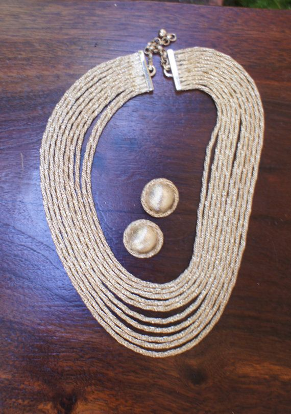 Lovely vintage silver multi-strand necklace with matching clip-on earrings. The necklace has ten slinky, spiral, chain strands and a simple