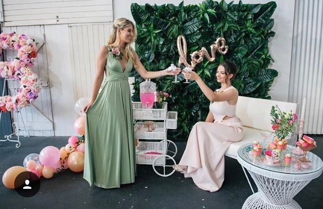 Convertible Gown paired with Pia Gladys Perey. Beautiful setting stunning mix. Both dresses available at Nora and Elle.