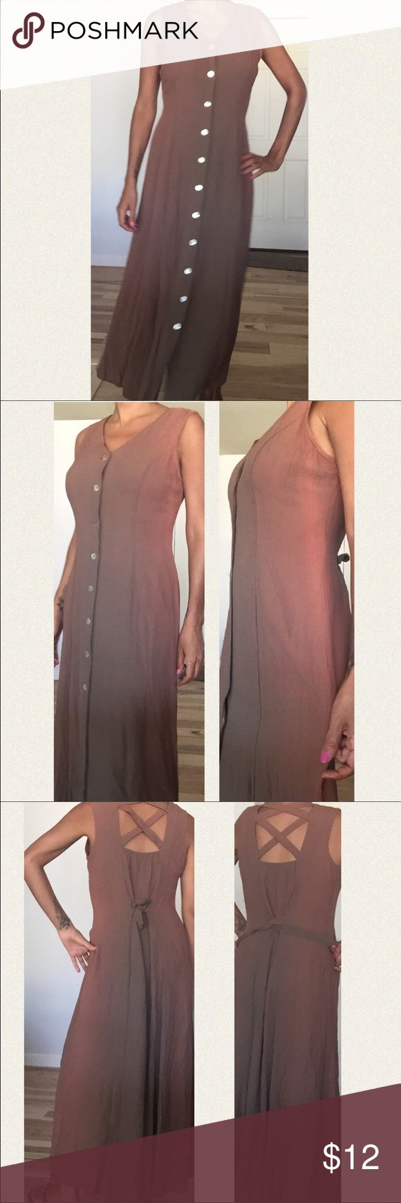 Long pretty dress This pretty dress changes color in the light. It's brown with red hues. It has pretty buttons that go down the front and it ties in the back. Fits size small to medium Dresses Maxi
