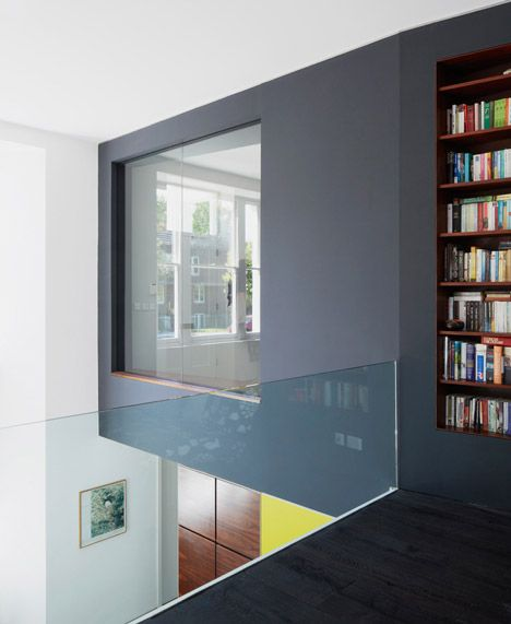 I like this recessed bookshelf against the black and simple glass balustrade