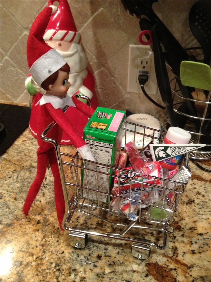Elf on the shelf goes shopping! Shopping cart made for cell phones can buy at any office supplies store.