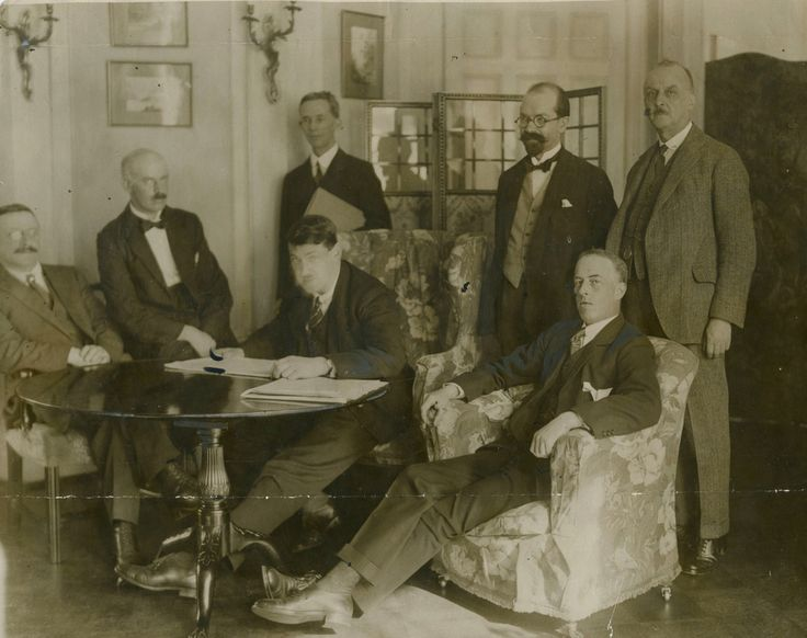 The delegation of Irish negotiators sent to London to negotiate with the British government the terms of Irish independence, October 1921 [[MORE]] Front [L-R] Arthur Griffith (1872-1922) Éamonn Duggan...