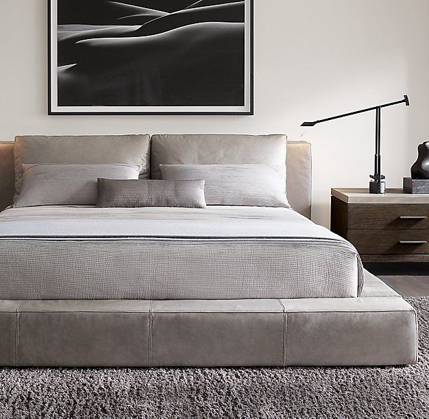 RH Modern's Cloud Platform Leather Bed:A nod to the relaxed modernism of mid-20th-century American design, our Cloud Platform Bed features a low, footless frame with a leather headboard, 100% goose feather back cushions and all-around wide rail.