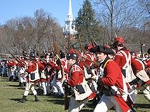 """Patriots Day, April 15, 2013 In Massachusetts, 236 years after the famous """"Shot heard 'round the world,"""" residents & visitors alike are still celebrating the momentous Battles of Lexington and Concord. Patriots Day, a state holiday established in 1969 to commemorate the opening battles of the American Revolutionary War. Festivities stretch over an entire weekend with parades, reenactments and commemorative ceremonies in Boston, Lexington, Concord & surrounding towns. All can come experience…"""