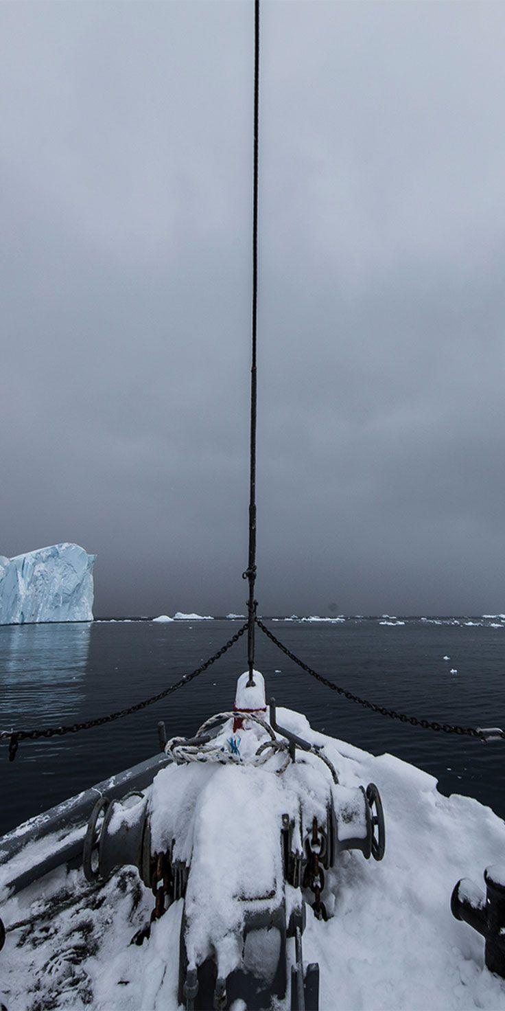 Sailing through icebergs on an old Greenlandic fishing boat - by Sean Scott