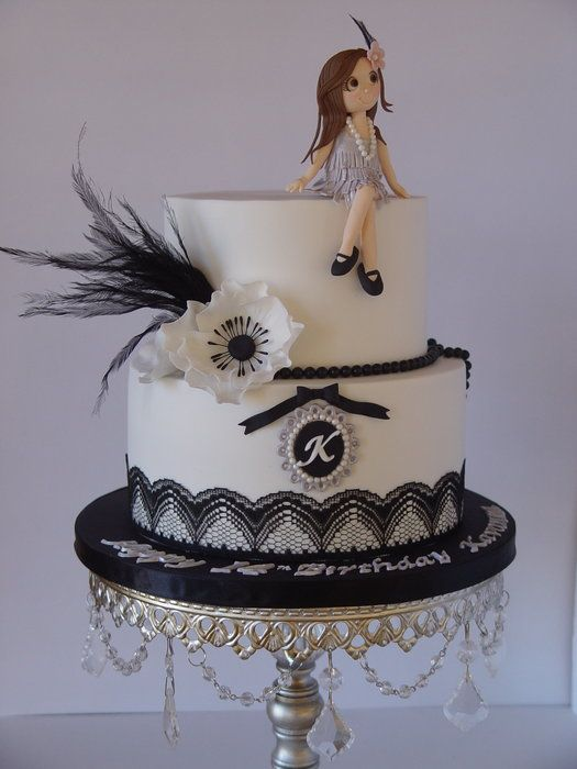 Love this cake - especially the girl in the flapper dress sat on top!