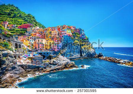 Beautiful colorful cityscape on the mountains over Mediterranean sea, Europe, Cinque Terre, traditional Italian architecture - stock photo