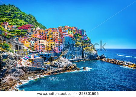 Beautiful colorful cityscape on the mountains over Mediterranean sea, Europe, Cinque Terre, traditional Italian architecture - stock photo