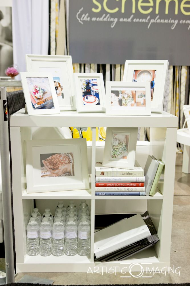 Try little bottles of water with branded labels? Baby/pregnancy books? Scheme - Las Vegas Wedding Planner trade show booth