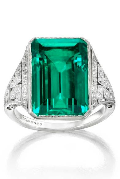 The Whitney Emerald: An Art Deco Platinum, Emerald, and Diamond Ring by Tiffany & Co., New York, circa 1925. A ring centering an emerald-cut emerald in a millegrain bezel accented on the sides with old European-cut diamonds in millegrain settings, the outline of the millegrain creating a four-leaf form; mounted in platinum • 1 emerald-cut emerald, weighing 8.51 carats • Old European-cut diamonds, total weighing approximately .50 carat • Signed Tiffany & Co.