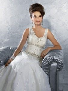 Net over Satin Gown withOrganza Ribbon. Embroidery with Metallic Accents, Rhinestones, Pearls, Crystal Beading & Sequins. Chapel length train. Click here to download the sizing chart