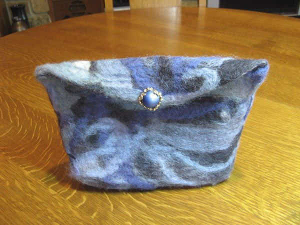 I used the quickest, easiest felting technique to make this darling little felted purse— and there was no knitting involved. So put down those needles, and try an entirely new way of working with wool.
