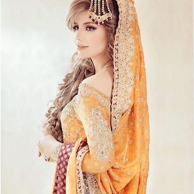 Anam Falak looking absolutely gorgeous on her Nikkah in a saffron #FarahTalibAziz traditional ensemble ✨ #FarahTalibAzizBrides