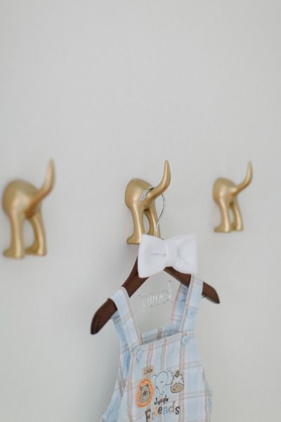 Puppy dog tails hooks! Get them from Ikea and spraypaint gold for a chic look in the nursery #BoyNusery #CarouselDesigns