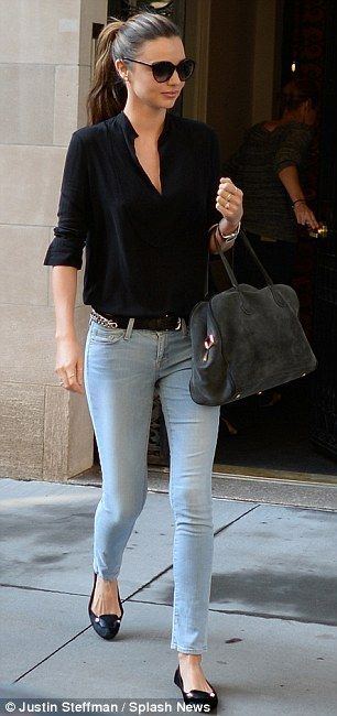 Fall #streetstyle | Miranda Kerr in a black The Row blouse, Frame Denim jeans, Balenciaga flats and a Balmain purse