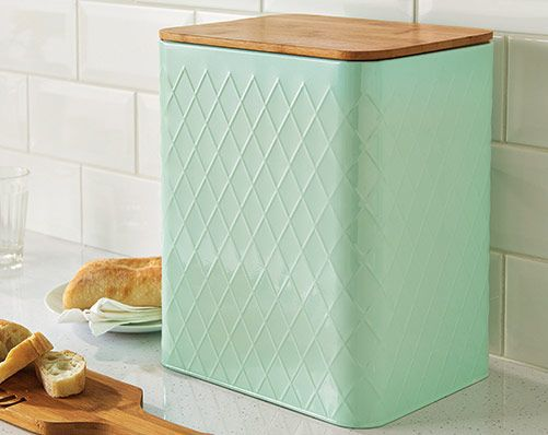 Pastel Bread Bin £18.00 Delicate pastel mint coloured bread bin complete with silicone seal bamboo lid. Powder coated metal body with embossed diamond design. Measures L25 x D21 x H31cm
