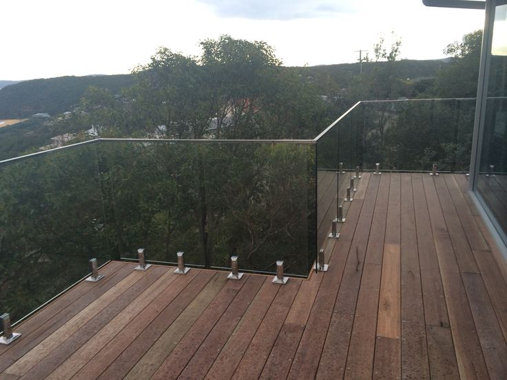 Frameless Glass Balustrade using Stainless Steel spigots with stainless steel top rail