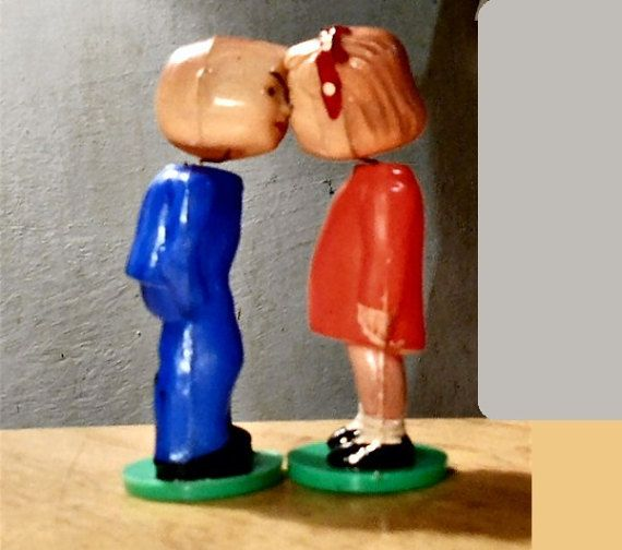 KISSING Celluloid Boy & GirlThey are Magnatized.  They by emenow