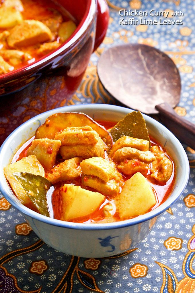 This delicious Nyonya Chicken Curry with Kaffir Lime Leaves is rich, creamy, spicy, and tangy. Kaffir lime leaves make the curry very aromatic.   RotiNRice.com