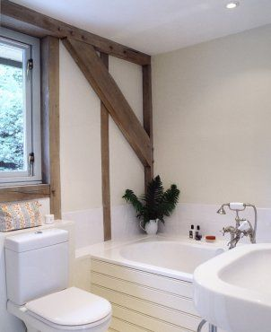 Simple bathroom in oak frame house