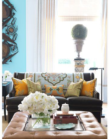 Bunny Williams. She loves to layer throws and pillows on solid coloured furniture. I love the ottoman with cushion and coffee table functionality!