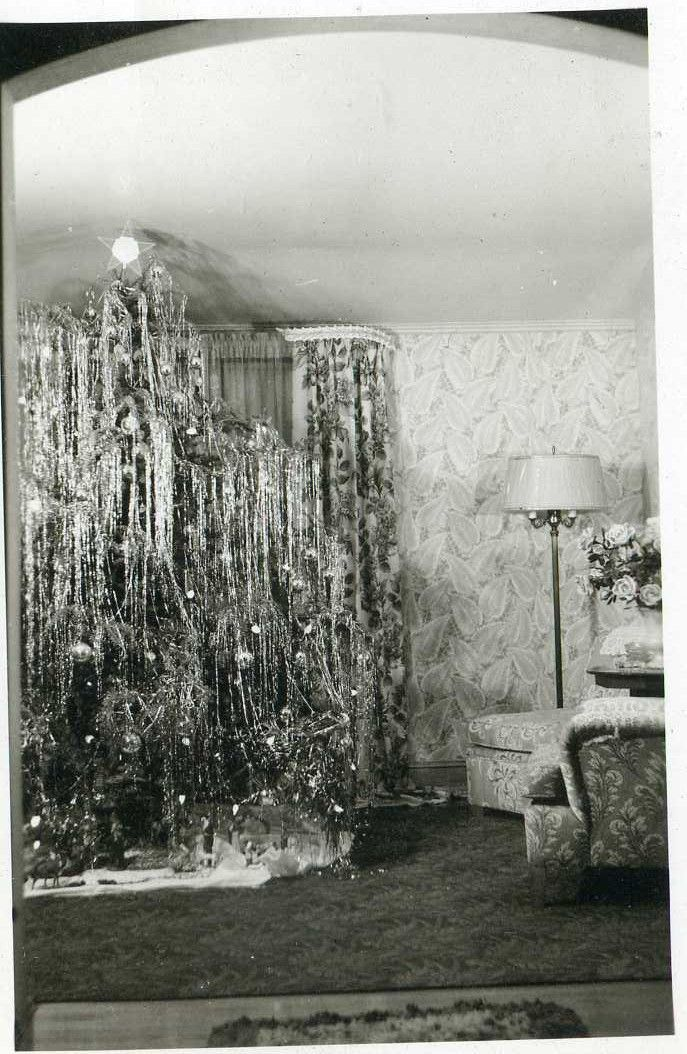 The old fashioned rug, the floor lamp and, of course, the Christmas Tree with Tinsel!