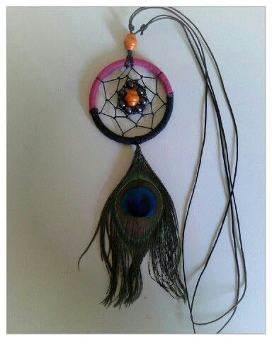 This is my fav necklace ever. DC with peacock feather. So stunning :-)