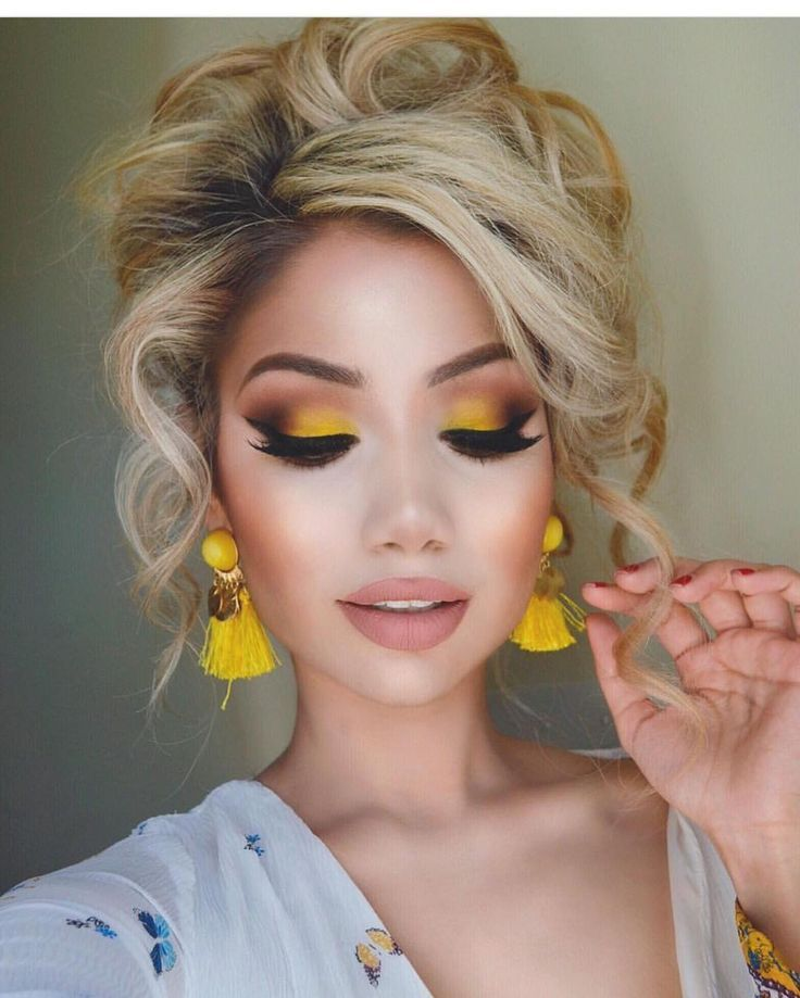 Yellow eye-shadow is not for the woman who wants to blend in with the crowd. You need to be bold and confident to pull off this look, but its spring so why not